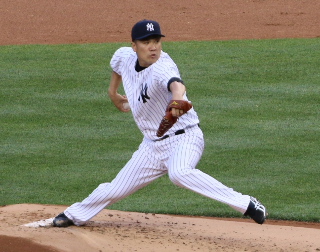 Masahiro Tanaka delivers a pitch in the second inning.