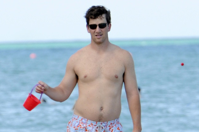 eli-manning-shirtless-pool-04022012-04_crop_650